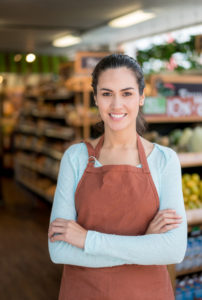 Woman Working At Supermarket Using Catapult Grocery POS